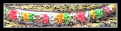 Plastic flowers in tube